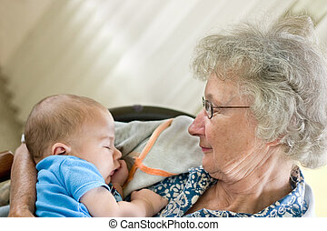 Grandmother\\\'s Love - a grandmother holding a new little...