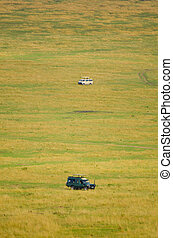 4x4 on Safari - Two all terrain vehicles on a road in the...