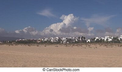 clouds running over white houses