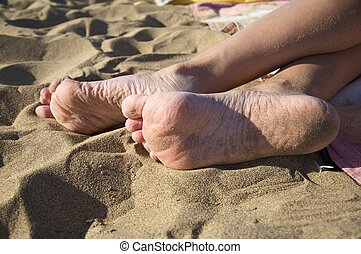 sole feet - nude sole of two woman feet at the beach