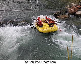 Daredevil athletes during the descent with the boat along an...