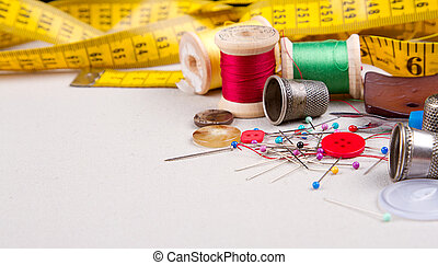 Sewing supplies, measuring tape, thread, pins, buttons and...