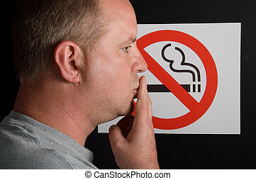 No Smoking Sign - A man smoking a no smoking sign