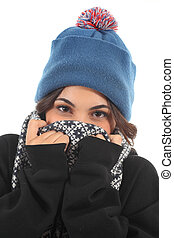 Very wrapped up girl is cold in a white isolated background