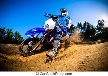 Enduro bike rider on action Turn on sand terrain