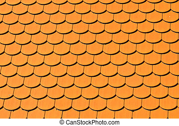 Pattern of red ceramic roof shingles