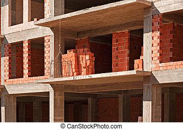 Wire basket hoist on construction site - Construction site,...