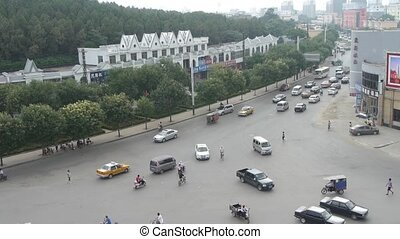Urban town busy road traffic,Asia China Chinese people.