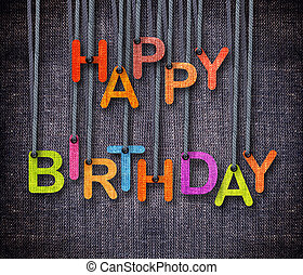 Happy Birthday hunging by rope as puppeteer on sackcloth...