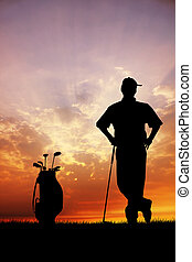 Golf at sunset - Golfers at sunset