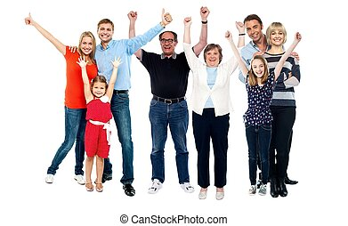 Three generations family portrait. Full length studio shot,...