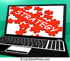 Strategy Puzzle On Notebook Showing Online Solutions