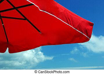 Sun umbrella - Bright red sun umbrella over a blue sky