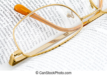 Glasses on Books - glasses lying on an open book - close up