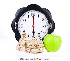 dietetic loaves with green apple and watches at 6 oclock -...