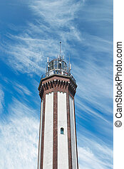 Lighthouse - Brick lighthouse on optimistic summer sky...