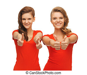 wo teenage girls in red t-shirts showing thumbs up - picture...