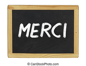 Merci written on a blackboard