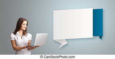 Attractive young woman holding a laptop and presenting modern origami copy space