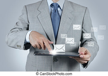 hand use tablet computer with email icon - businessman hand...