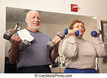 Senior Adult Couple Working Out in the Gym - Active Senior...