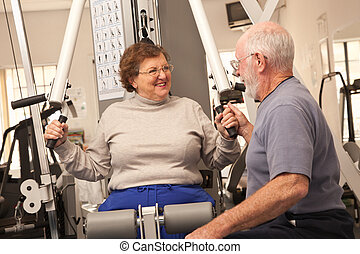 Senior Adult Couple Working Out Together in the Gym - Active...
