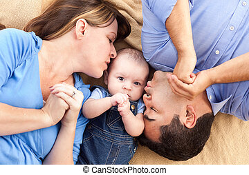 Mixed Race Family with Baby Playing on the Blanket