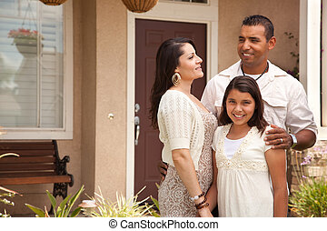 Small Happy Hispanic Family in Front of Their Home - Happy...