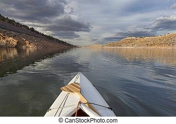 canoe on mountain lake