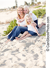 Pretty Mom and Her Cute Daughters at The Beach - Pretty Mom...