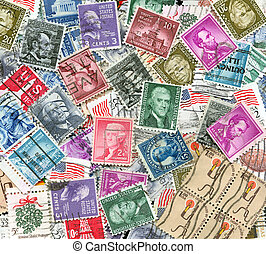 backdrop of old US postage stamps - background of...