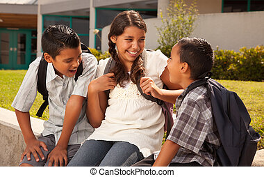 Hispanic Brothers and Sister Talking Ready for School