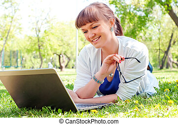 portrait of a woman witha laptop - portrait of a beautiful...