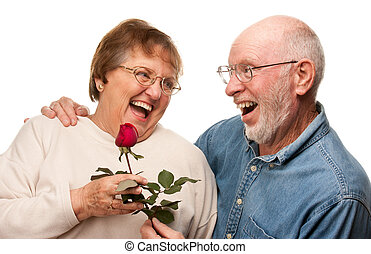 Happy Senior Husband Giving Red Rose to Wife