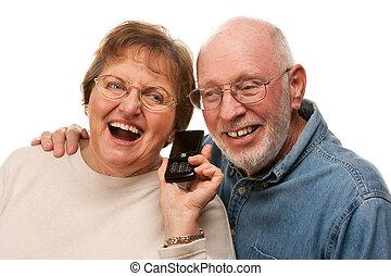 Happy Senior Couple Using Cell Phone on White - Happy Senior...