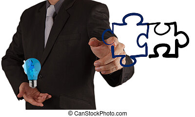 puzzle partnership - businessman hand shows light and puzzle...