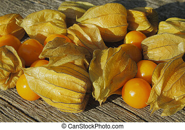 Golden Strawberry (Physalis) on a wooden table