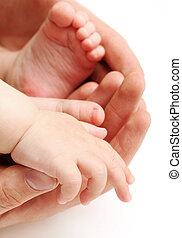 Baby`s foots in father hands isolated on a white