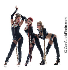 Three women in sexy latex costumes with switch