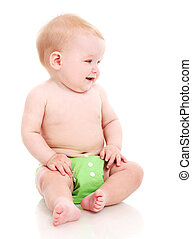 Cute little baby in green diapers