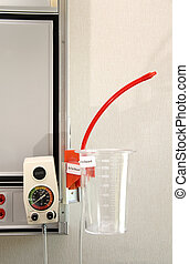 Hospital Suction Unit - A suction unit for chest tubes in a...