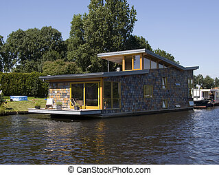 houseboat - modern houseboat with blue sky