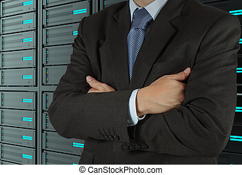 businessman using tablet computer and server room background...