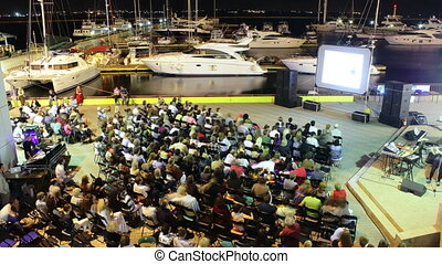 People watching movies at Open Air Film Festival in marina timelapse,4K