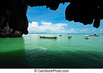 Vision from inside cave and tourism boat.