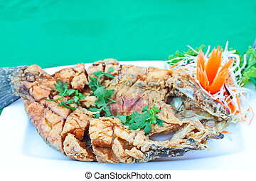 Fried bass fish with fish sauce
