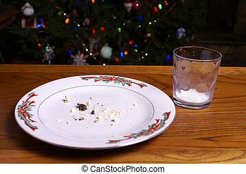 Christmas Cookie Crumbs and Empty Milk Glass - A plate of...