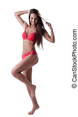 Happy beautiful young woman in red underwear