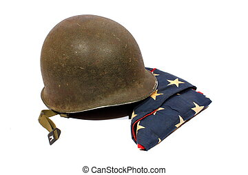 Helmet and Flag - Isolated World War 2 army helmet with the...