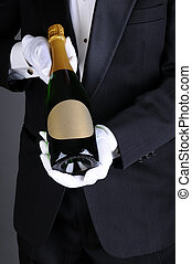 Sommelier Presenting Champagne Bottle - Closeup of a...